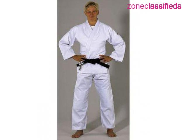 A single weave, medium weight, bleached white Judo uniform of exceptional quality and value. - 1/1